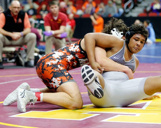 Gabriel Greenlee of Ames defeated Maddux Borcherding-Johnson of Norwalk during their 3a semifinal round match at Wells Fargo Arena Friday, Feb. 21, 2020.