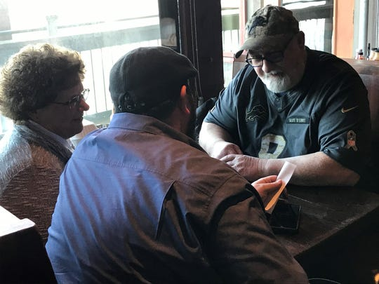 Detroit Lions coach Matt Patricia picks up the tab for Lions fans Ron Holman, 63, of Muskegon, and his wife Nancy on Friday, Feb. 14, 2020, in Troy, N.Y.