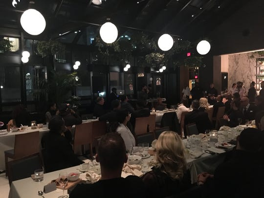 """Guests gather with Royce da 5'9"""" at the Shinola Hotel on Feb. 21, 2020, for a dinner party celebrating his album """"The Allegory."""""""