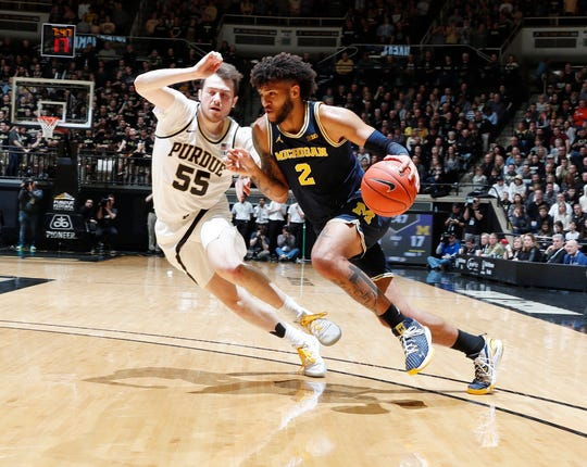 Michigan forward Isiah Livers drives to the basket against Purdue guard Sasha Stefanovic during the first half on Saturday, Feb. 22, 2020, in West Lafayette, Ind.