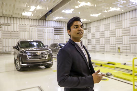 Sound Engineer Jigar Kapadia tests sounds on new vehicles like the 2021 Cadillac Escalade in the anechoic chamber at the General Motors Proving Grounds on Saturday in Milford.