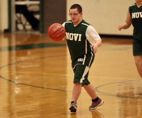 Michael Manning dribbles during a KLAA Unified Sports League game at Novi on Thursday, Feb. 20, 2020, at Novi High School.