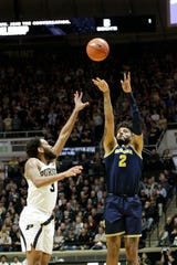 Michigan forward Isaiah Livers goes up for 3 against Purdue guard Jahaad Proctor during the first half of U-M's 71-63 win on Saturday, Feb. 22, 2020, in West Lafayette, Indiana.