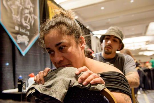 Tattoo artist Bale Sisneros worked with client Jo Ann Ramírez at last year's Motor City Tattoo