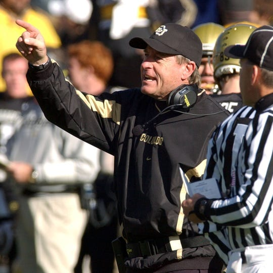 Colorado football coach Gary Barnett yells instructions to his players in Boulder, Colorado, on Nov. 28, 2003.