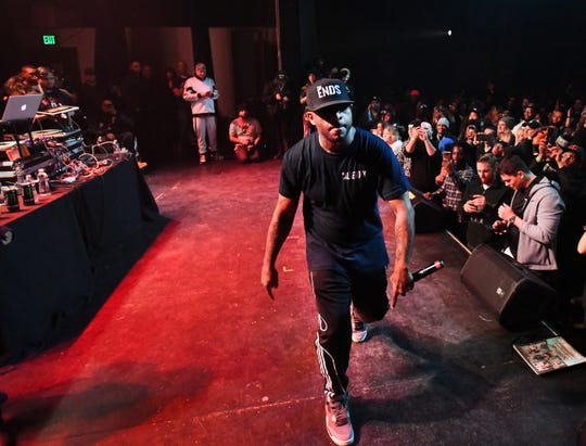 "Rapper and songwriter Royce da 5'9"", Ryan Montgomery, paces the stage while performing at the Garden Theater in Detroit."