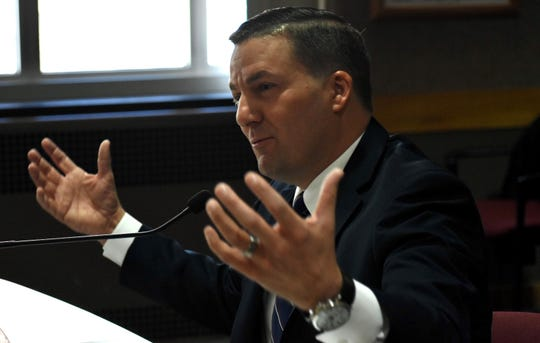 Oak Park City Manager Erik Tungate answers questions from the city commissioners and the mayor.