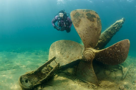 A diver explores the shallow wreck of the Monohansett in the Thunder Bay National Marine Sanctuary.
