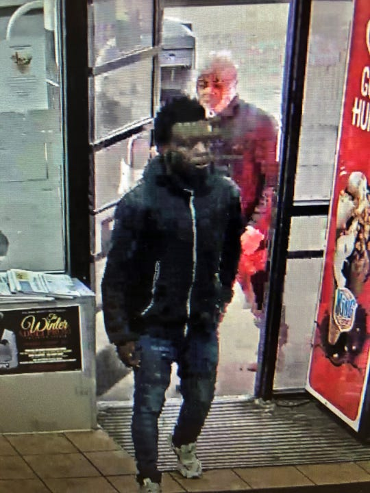 Suspect #2, on the right, was captured on surveillance footage with Gray at about 8:20 a.m. Feb 12.
