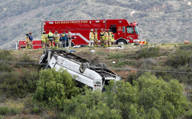 A bus rolled down an embankment off Interstate 15 in North San Diego County Saturday, Feb. 22, 2020, killing several people and injuring others.