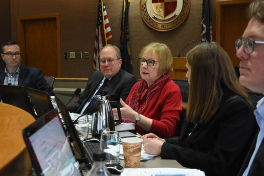 Royal Oak Mayor Michael Fournier, left, City Attorney David Gillam, Mayor Pro Tem Pat Paruch and commissioners Melanie Macey and Randy LeVasseur question city manager candidate Sheryl Mitchell, Lathrup Village city administrator at City Hall in Royal Oak on Feb. 22, 2020.