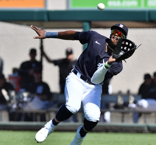 Tigers right fielder Cameron Maybin makes a running catch in the second inning.