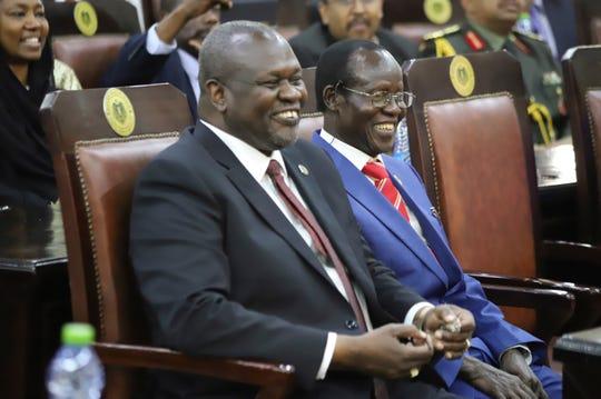 Dr. Riek Machar, left, after swearing in ceremony in Juba, South Sudan Saturday, Feb. 22, 2020.