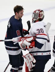 Team Knuble's Jake Sanderson, left, and Team Gomez goalie Aiden McCarthy shake hands after the BioSteel All-American Game at USA Hockey Arena in Plymouth.