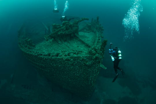 Divers explore the New Orleans 2 in the Thunder Bay National Marine Sanctuary.