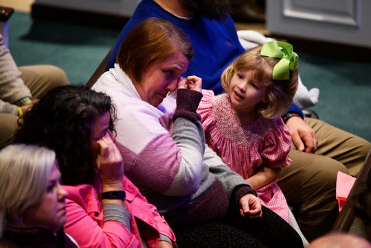 A woman wipes tears from her eyes during the remembrance service for six-year-old Faye Swetlik at Trinity Baptist Church Cayce Friday, Feb. 21, 2020.