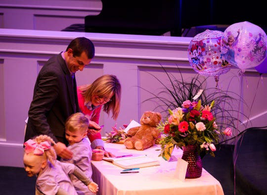 Children hug a couple as they write a note for the family of six-year-old Faye Swetlik before her remembrance service at Trinity Baptist Church Cayce Friday, Feb. 21, 2020.