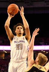 Furman's Jalen Slawson (20), shown in a game earlier in the 2019-20 season, had 17 points and nine rebounds in a win at UNC Greensboro on Wednesday night.