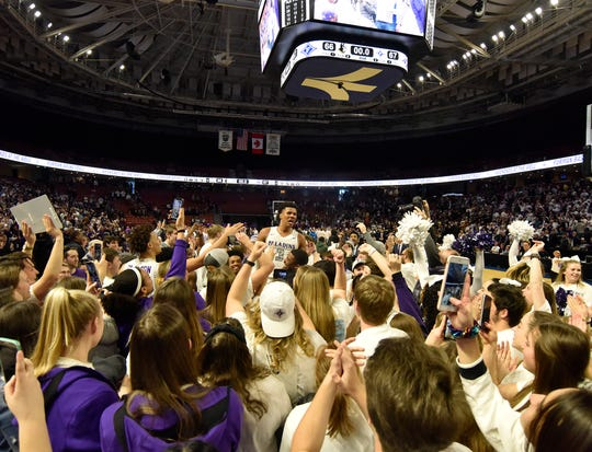 Furman's Mike Bothwell, center, celebrates defeating Wofford 67-66 Saturday, Feb. 22, 2020 at The Well.