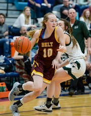 Belt's Kyelie Marquis dribbles passed a Tri-City defender during the semifinal round of the District 8C Basketball Tournament on Friday in Great Falls.