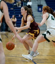Belt's Kolby Pimperton handles the ball during Friday's semifinal game against Tri-City during the District 8C Basketball Tournament in Great Falls.
