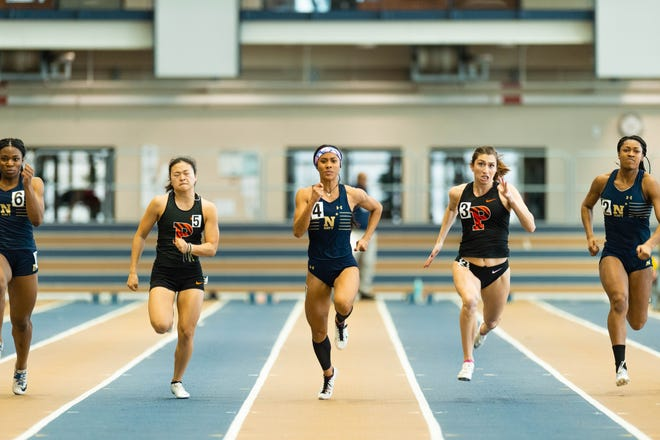 Regine Tugade, a senior track and field star for the U.S. Naval Academy at Annapolis, set a new school record and Guam national record in the 200-meter sprint, running a 24.31. Feb. 21 at Annapolis.