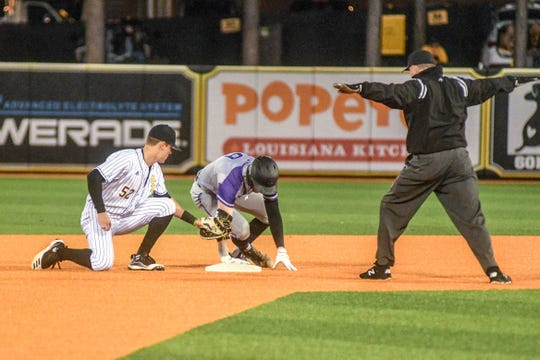 Central Arkansas Bears outfielder runs to second base as Southern Miss second baseman Brant Blaylock tries to get him out during their NCAA baseball game against Southern Miss at Pete Taylor Park in Hattiesburg, Miss. Friday, Feb. 21, 2020.