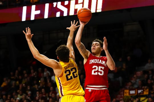 Hoosiers forward Race Thompson (25) shoots the ball against Minnesota Golden Gophers guard Gabe Kalscheur (22) in the first half at Williams Arena.