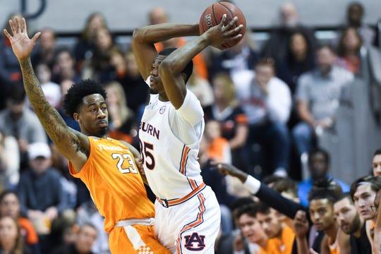 Tennessee guard Jordan Bowden (23) defends Auburn guard Devan Cambridge (35) during the first half of an NCAA college basketball game Saturday, Feb. 22, 2020, in Auburn, Ala. (AP Photo/Julie Bennett)