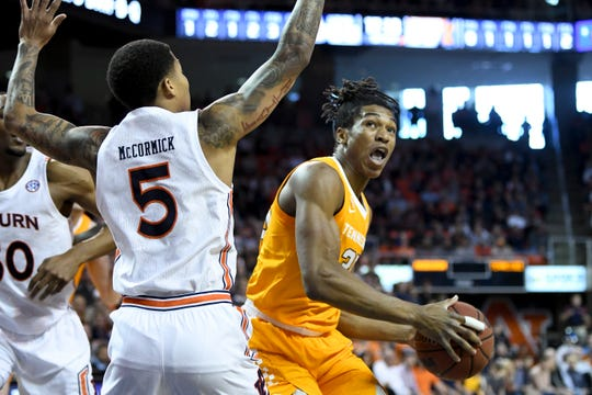 Tennessee guard/forward Yves Pons (35) shoots over Auburn guard J'Von McCormick (5) during the first half of an NCAA college basketball game Saturday, Feb. 22, 2020, in Auburn, Ala. (AP Photo/Julie Bennett)