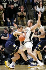 Michigan guard Franz Wagner (21) dribbles against Purdue forward Evan Boudreaux (12) during the first half of a NCAA men's basketball game, Saturday, Feb. 22, 2020 at Mackey Arena in West Lafayette.