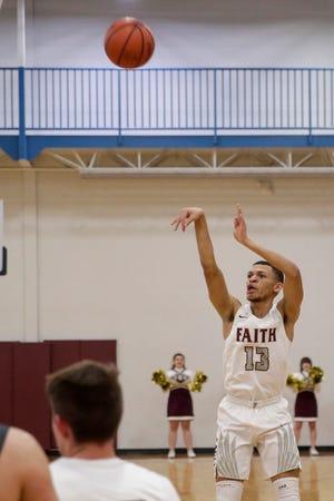 Faith Christian's Immanuel Mitchell (13) shoots during the first quarter of an IHSAA boys basketball game, Friday, Feb. 21, 2020 in Lafayette.