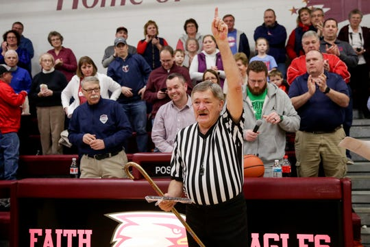 Larry Nixon acknowledges the crowd after being honored, Friday, Feb. 21, 2020 in Lafayette. Nixon, who has officiated basketball for the IHSAA for 50 years, officially retired after Friday night's game.
