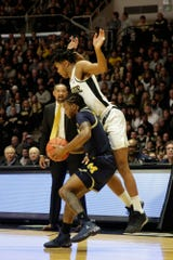 Purdue guard Nojel Eastern (20) collides with Michigan guard Zavier Simpson (3) during the first half of a NCAA men's basketball game, Saturday, Feb. 22, 2020 at Mackey Arena in West Lafayette.