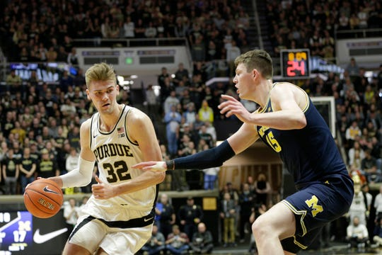 Purdue center Matt Haarms (32) dribbles against Michigan center Jon Teske (15) during the first half of a NCAA men's basketball game, Saturday, Feb. 22, 2020 at Mackey Arena in West Lafayette.