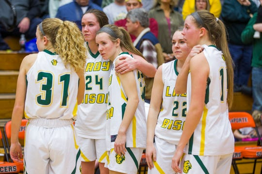 Benton Central players console each other following the Bison's 36-22 loss to Northwood in an IHSAA Class 3A semi-state girls basketball game on Saturday, Feb. 22, 2020, at LaPorte High School in LaPorte.