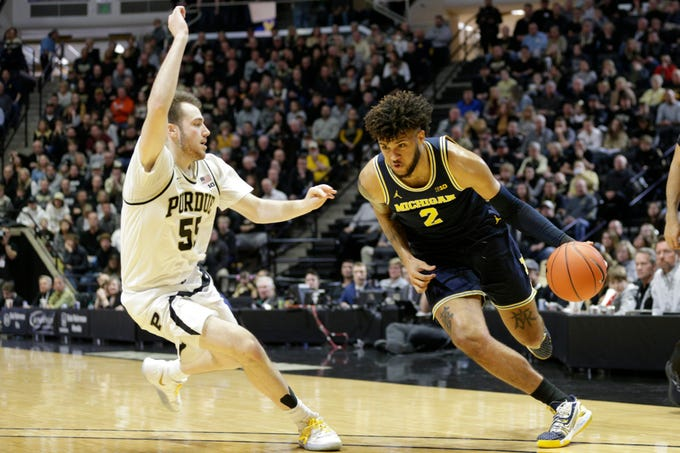 Michigan forward Isaiah Livers (2) dribbles against Purdue guard Sasha Stefanovic (55) during the first half of a NCAA men's basketball game, Saturday, Feb. 22, 2020 at Mackey Arena in West Lafayette.