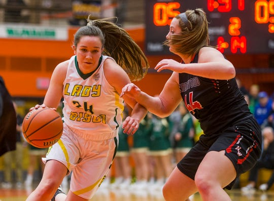 Benton Central's Audrey Strawsma, left, drives around Northwood's Kate Rulli during the IHSAA Class 3A semi-state girls basketball game on Saturday, Feb. 22, 2020, at LaPorte High School in LaPorte.