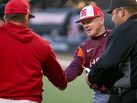 "Virginia Tech's head coach John Szefc at home plate before the game as the Ragin' Cajuns take on the Virginia Tech Hokies at M.L. ""Tigue"" Moore Field on Friday, Feb. 21, 2020."