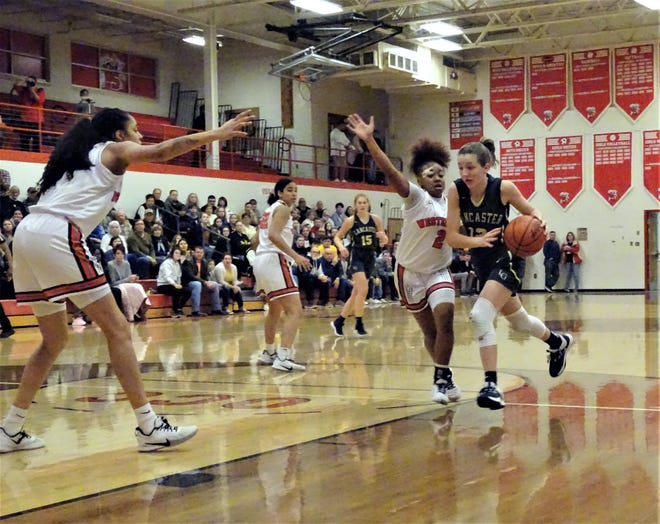 Lancaster freshman guard Riley Spangler takes the ball to the basketball against Westerville South during the Lady Gales' 56-29 Division I tournament loss Friday night.