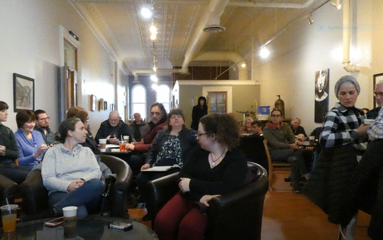 Mansfield City Councilwoman Jeanne Taddie, center, asked a question Friday night at the Ohio for Warren small town listening tour at Relax It's Just Coffee downtown Mansfield.