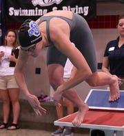 Ontario freshman Bri Trumpower takes off in the 100 freestyle race