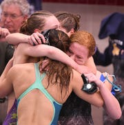 Ontario's 200 freestyle relay team celebrates its fifth place finish at the state meet.