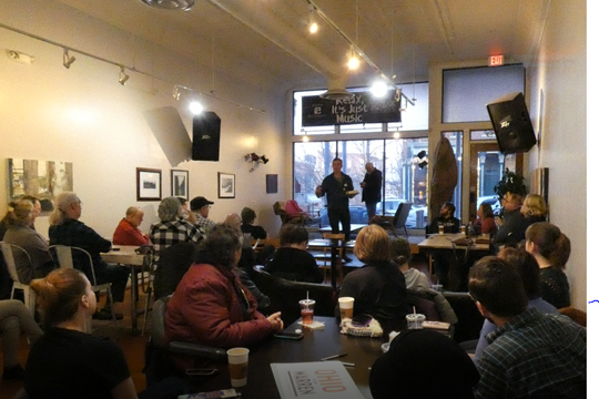 John Russell, the Ohio for Warren rural outreach coordinator, took questions from supporters for Elizabeth Warren for president Friday night downtown.