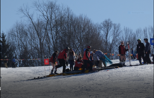 A woman in the bikini race Saturday at Snow Trails was injured when she took a spill going down Mount Mansfield. Employees at the event said she was expected to be OK. Ski patrol brought her down the hill.