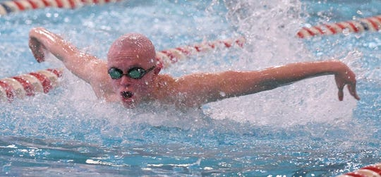 Lexington sophomore Tanner Holmes competes in the 100 butterfly