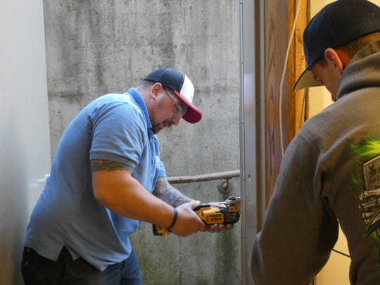 Devin Boucher, of Vector Security, works on installing part of the security system at what will be the Marion County Jail Alternative Center. County officials plan to open the jail alternative in the spring, where misdemeanor offenders will be able to serve their sentences in a less restrictive setting.