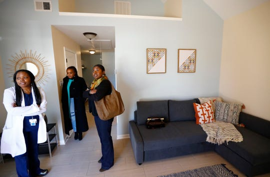 Lanetta Anderson, from left, Roshun Austin and Portia Ponds tour one of Dwayne Jones' two tiny homes, 480 square feet each, in the Orange Mound neighborhood.