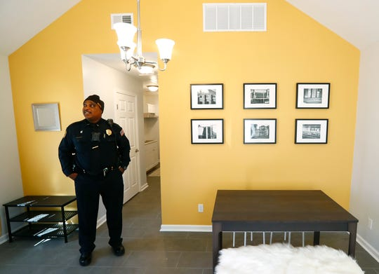 Memphis Police Lt. Clyde Jefferson stops in to take a look at one of Dwayne Jones' completed tiny homes in the Orange Mound neighborhood.