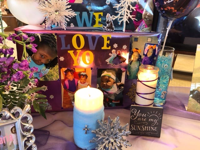 Photos of Amarah Jerica Banks' children were displayed during the memorial service Saturday for Banks and her two daughters.